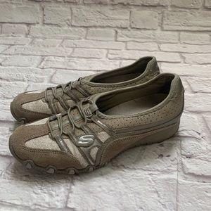 Skechers woman's slip on walking shoes